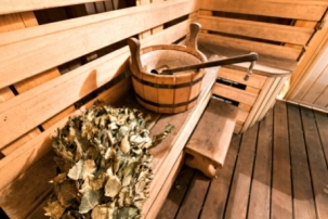 Empty wooden sauna room with ladle, bucket ready to be used